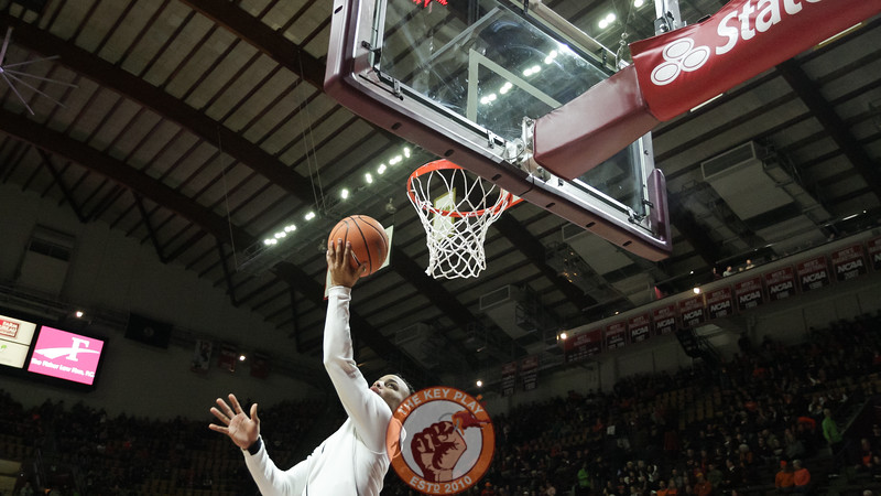 Justin Robinson jumps up for a layup during pre-game warmups. (Mark Umansky/TheKeyPlay.com)