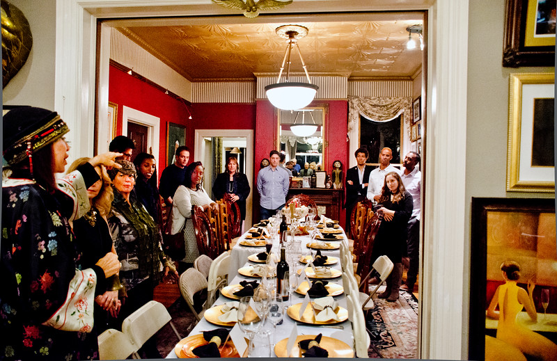 "Sheila Ash directing guests at her dinner party for ""Home Hospitality Opportunities: Leadership Development in Israel"""