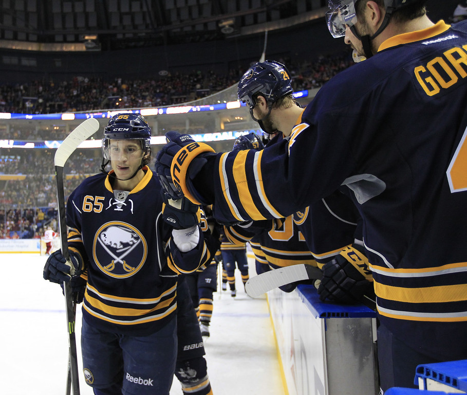 . Buffalo Sabres\' Brian Flynn is congratulated by teammates after scoring against the Detroit Red Wing during second period action of an NHL hockey game, Sunday, Nov. 2, 2014, in Buffalo, N.Y. (AP Photo/The Buffalo News, Harry Scull Jr)