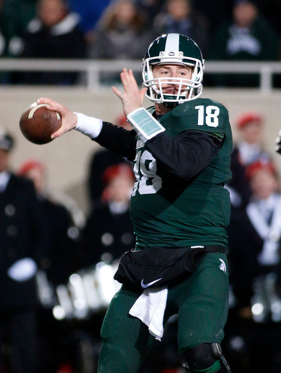 . Michigan State quarterback Connor Cook looks to pass against Ohio State during the first quarter of an NCAA college football game, Saturday, Nov. 8, 2014, in East Lansing, Mich. (AP Photo/Al Goldis)