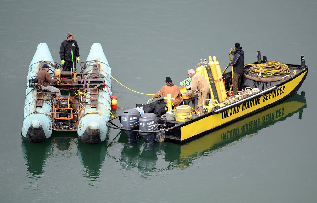 . This photo released by Ouray County, shows salvage operations to recover the victims and plane, Thursday March 27, 2014, at the Ridgway Reservoir near Ridgway, Colo., at the site of a downed aircraft, which crashed last Saturday, March 22, 2014, killing five people from Alabama. (AP Photo/Ouray County, William Woody)
