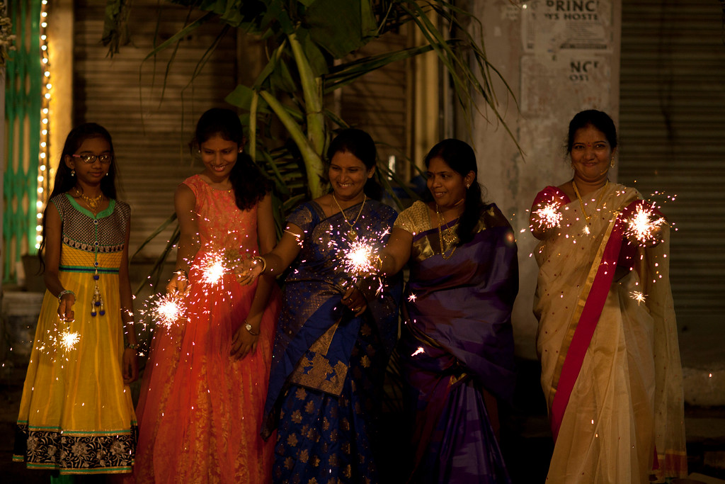 . Indians play with firecrackers to celebrate Diwali in Hyderabad, India, Thursday, Oct. 19, 2017. Hindus light lamps, wear new clothes, exchange sweets and gifts and pray to goddess Lakshmi during Diwali, the festival of lights. (AP Photo/Mahesh Kumar A.)