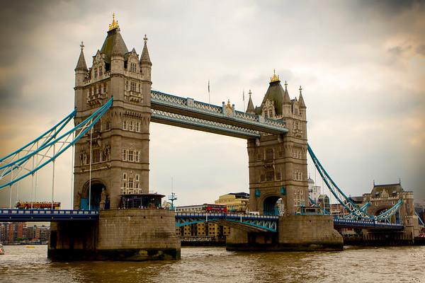 Red London Bus Crosses Tower Bridge, London