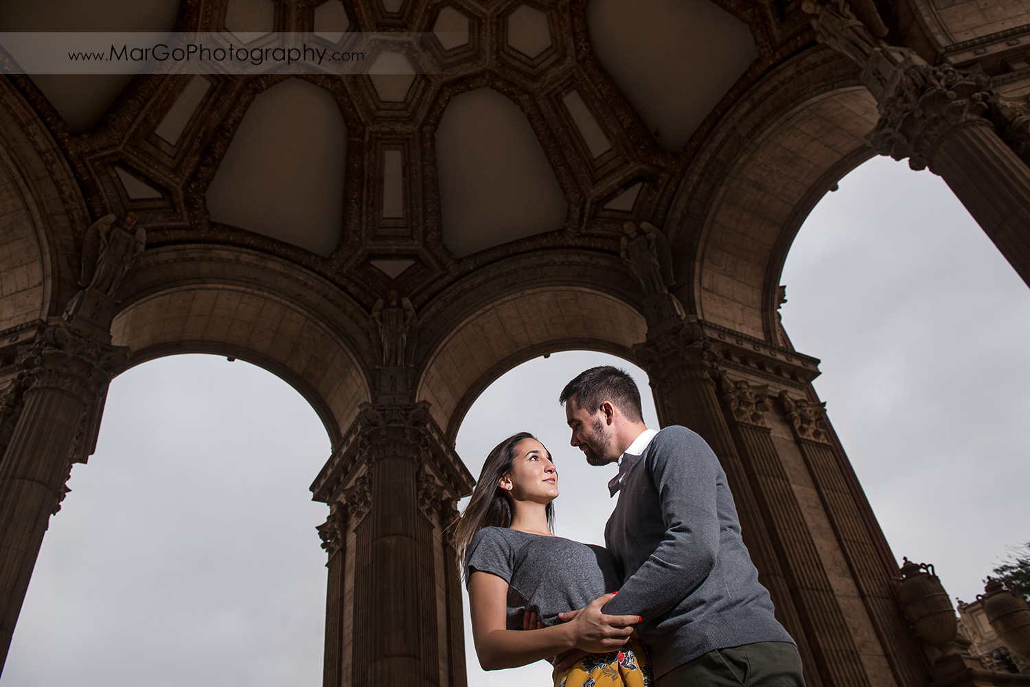 engagement session at Palace of Fine Arts in San Francisco - couple under the dome