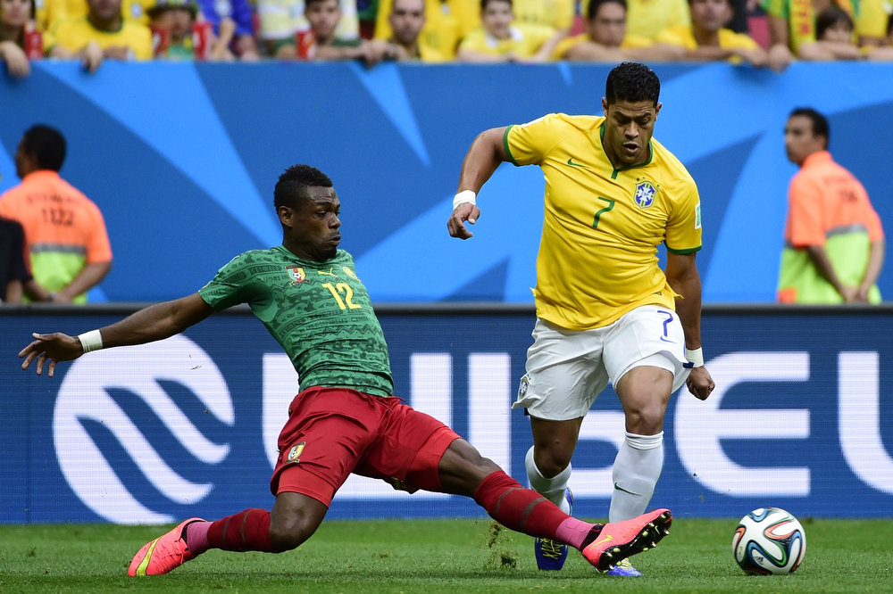 . Brazil\'s forward Hulk (R) vies with Cameroon\'s defender Henri Bedimo during a Group A football match between Cameroon and Brazil at the Mane Garrincha National Stadium in Brasilia during the 2014 FIFA World Cup on June 23, 2014.       PIERRE-PHILIPPE MARCOU/AFP/Getty Images