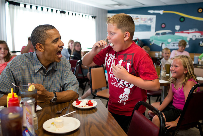 . July 5, 2012 ""\'Anyone want to try a piece of my strawberry pie,' the President asked those at adjacent tables during a stop for lunch at Kozy Corners restaurant in Oak Harbor, Ohio. A young boy said yes and came over for a big bite of pie."" (Official White House Photo by Pete Souza)800|534|?|a23e62147f07f81a87a8838856983306|False|UNLIKELY|0.3855181634426117