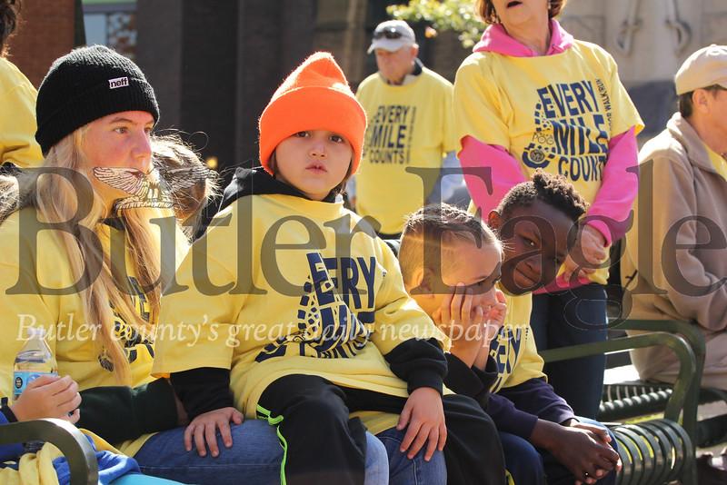 St. Vincent de Paul Friends of the Poor walkers take a break in Diamond Park Saturday. Seb Foltz/Butler Eagle