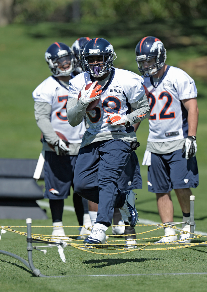 . C.J. Anderson (39) RB of the Denver Broncos runs through drills during OTAs June 3, 2013 at Dove Valley. (Photo By John Leyba/The Denver Post)