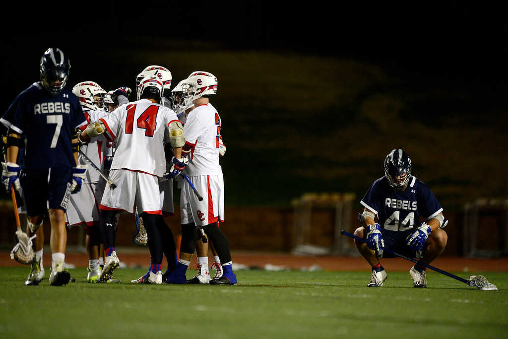 . Cherry Creek celebrates a goal as Columbine\'s Auston Stackhouse (7) and John Lisella (44) react during Cherry Creek\'s 7-6 win.  (Photo by AAron Ontiveroz/The Denver Post)