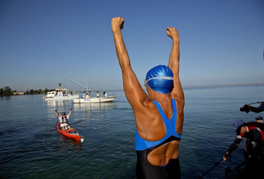 . U.S. swimmer Diana Nyad, 64, greets her support team before her swim to Florida from Havana, Cuba, Saturday, Aug. 31, 2013. Endurance athlete Nyad launched another bid Saturday to set an open-water record by swimming from Havana to the Florida Keys without a protective shark cage.   (AP Photo/Ramon Espinosa)