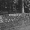 NJ910958A-LongView, Man marking Ordnance Survey minor control revision point with an arrow in 1950s