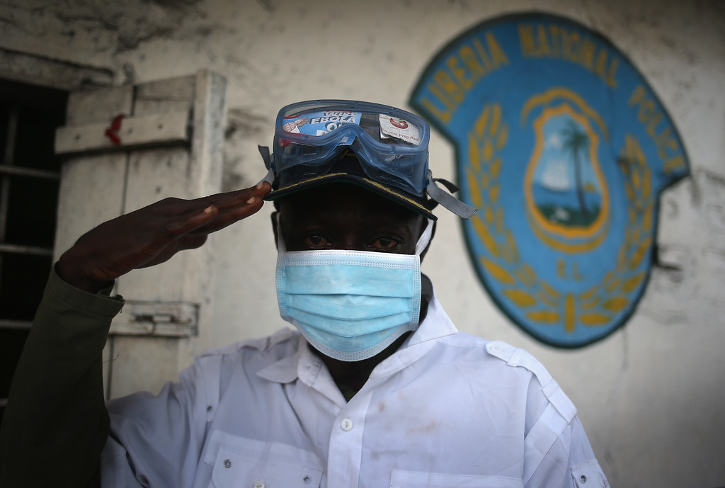 . A Liberian police assistant wait to check people\'s temperatures at a police station in the West Point township on January 24, 2015 in Monrovia, Liberia. With Ebola cases now in single digits nationwide, officials continue to remain vigilant, although many Liberians have begun to return to normal life.  (Photo by John Moore/Getty Images)