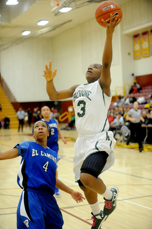 . 02-23-2012--(LANG Staff Photo by Sean Hiller)- Narbonne beat El Camino Real 47-39 in Saturday\'s L.A. City Section Division I semifinal girls basketball game. Kayla Brady dominates for Narbonne. Latecia Smith (3) goes to the basket over El Camino\'s 	Sukari Richardson (4).