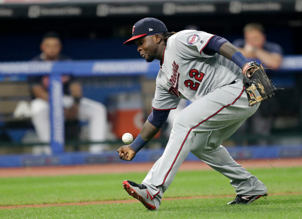 . Minnesota Twins\' Miguel Sano can\'t get to a bunt by Cleveland Indians\' Brandon Guyer during the fifth inning of a baseball game, Wednesday, Aug. 8, 2018, in Cleveland. Guyer was safe at first base for a single. (AP Photo/Tony Dejak)