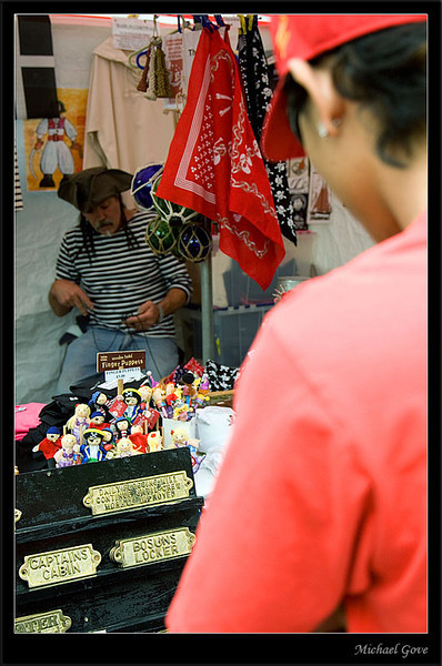 Stall owner peers at the strange photographer (83000861).jpg