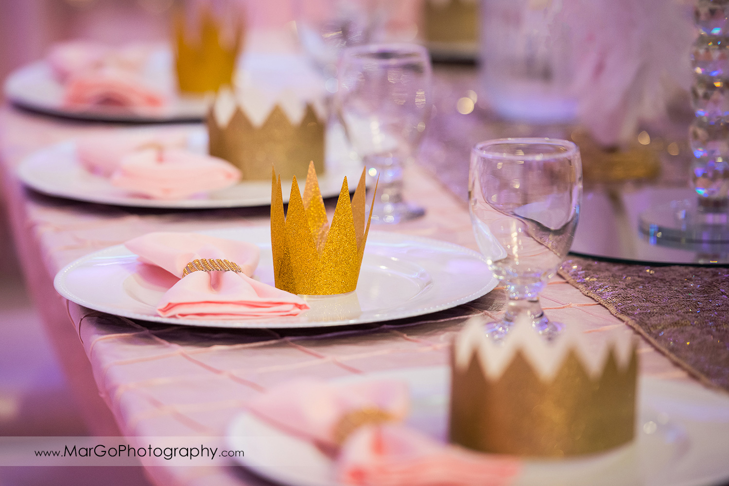 pink napkins and gold crowns plates decor at Newark Oasis Palace