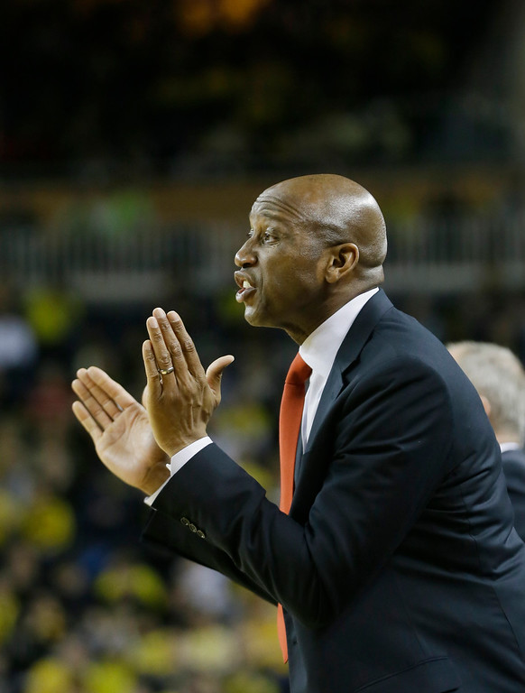 . Ohio State assistant coach Dave Dickerson yells from the bench during the first half of an NCAA college basketball game against Michigan, Sunday, Feb. 22, 2015 in Ann Arbor, Mich.  (AP Photo/Carlos Osorio)