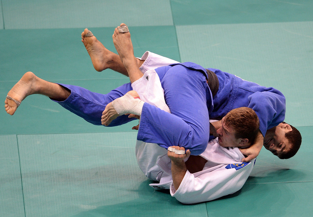. France\'s Loic Pietri(white) competes with Georgia\'s Avtandili Tchrikishvili during the 81kg category final of the IJF World Judo Championship in Rio de Janeiro, Brazil, on August 29, 2013.  VANDERLEI ALMEIDA/AFP/Getty Images