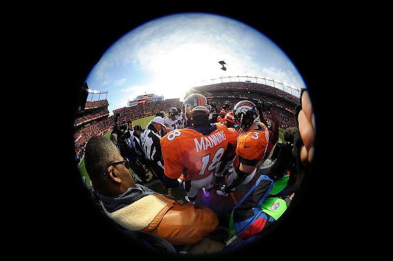 . Denver Broncos quarterback Peyton Manning (18) watches the coin toss prior to the game.  The Denver Broncos vs Baltimore Ravens AFC Divisional playoff game at Sports Authority Field Saturday January 12, 2013. (Photo by John Leyba,/The Denver Post)