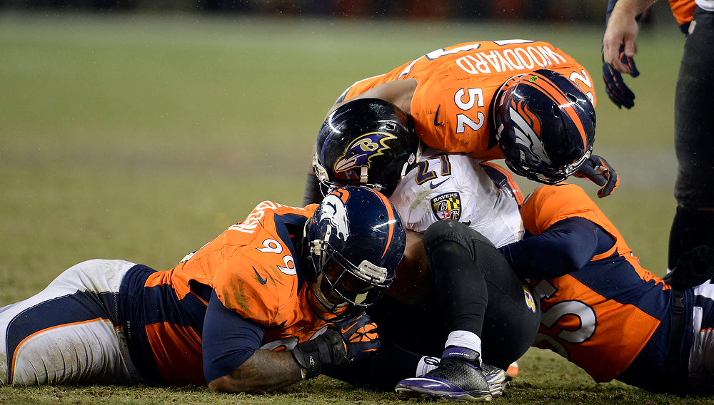 Description of . Baltimore Ravens running back Ray Rice (27) gets piled on during overtime.  The Denver Broncos vs Baltimore Ravens AFC Divisional playoff game at Sports Authority Field Saturday January 12, 2013. (Photo by John Leyba,/The Denver Post)