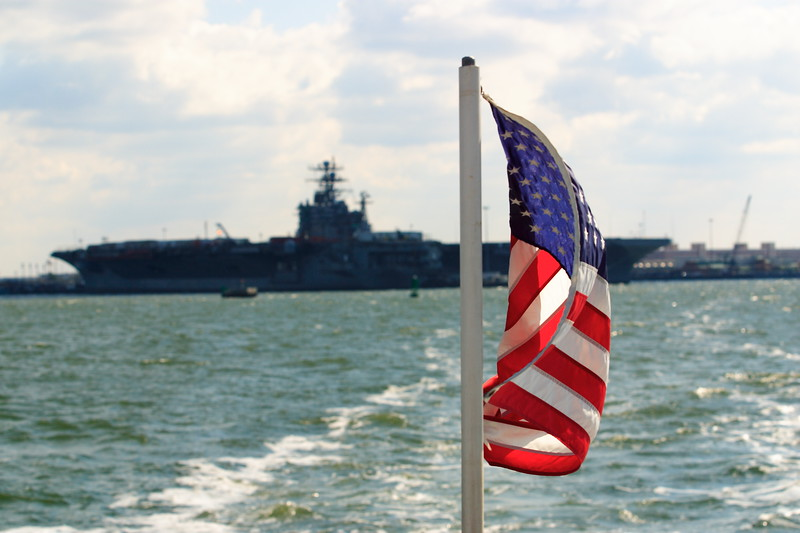 US Flag and unknown carrier in Norfolk, VA. © 2005 Kenneth R. Sheide