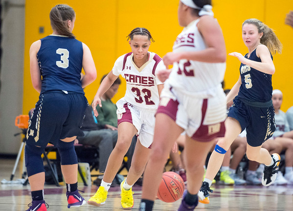 01/0719 Wesley Bunnell | StaffrrNew Britain girls basketball vs Newington at NBHS on Tuesday evening. Raven Symon Jarrett (32) brings the ball up court.
