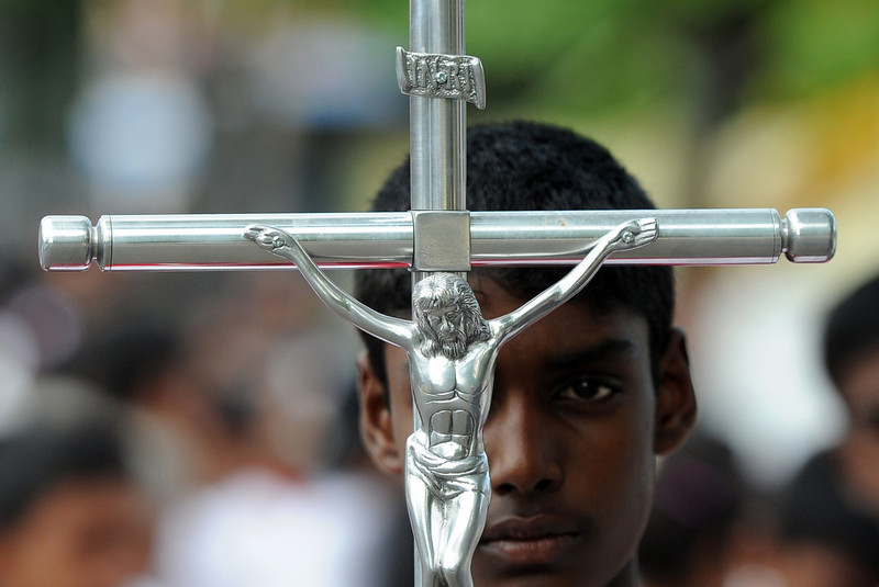 . Sri Lankan Christian devotees take part in the annual Way of the Cross ritual, which symbolizes the final journey of Jesus Christ before he was crucified, during a Good Friday service in Colombo on April 18, 2014. Christians account for around six percent of Sri Lanka\'s 20 million population. (LAKRUWAN WANNIARACHCHI/AFP/Getty Images)