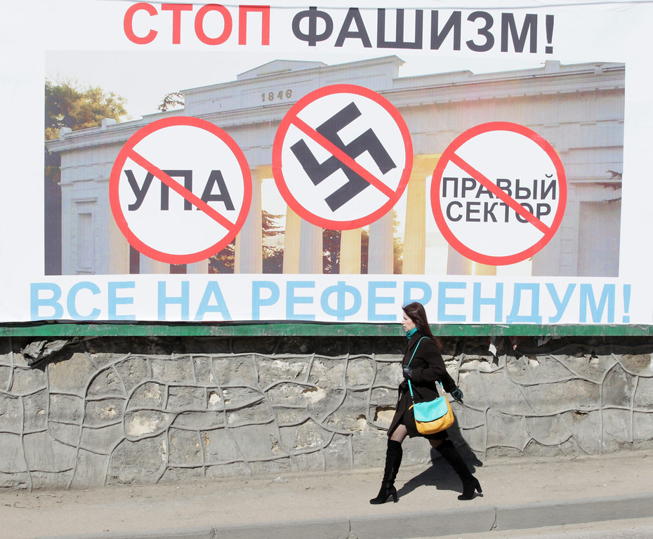 . A woman walks next to a poster calling people to vote in the upcoming referendum in the Crimea, is seen in Sevastopol, Ukraine, 13 March 2014. Crimea\'s parliament moved the date of an all-Crimean referendum on the status of the autonomous Republic of Crimea to 16 March. Crimea\'s secessionist authorities said on 12 March that they have partially closed the region\'s airspace to \'keep out provocateurs\', in the run-up to the March 16 referendum about joining Russia.  EPA/ZURAB KURTSIKIDZE