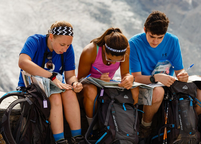 Ellie, Whitney, and Eric mapping their hike