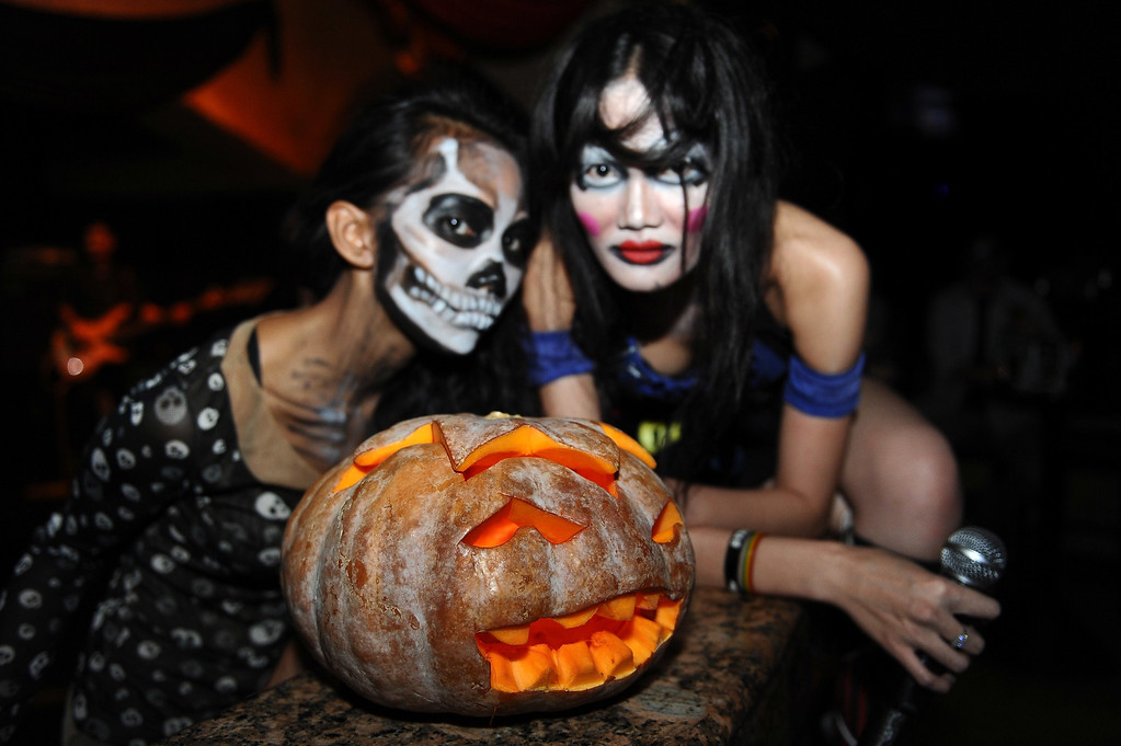 . Revelers gather for a Halloween party at Shangri-La Hotel Surabaya on October 31, 2013 in Surabaya, Indonesia.  Revelers across the country are celebrating Halloween the day before the Christian All Saints\' Day, which honors the dead.  (Photo by Robertus Pudyanto/Getty Images)