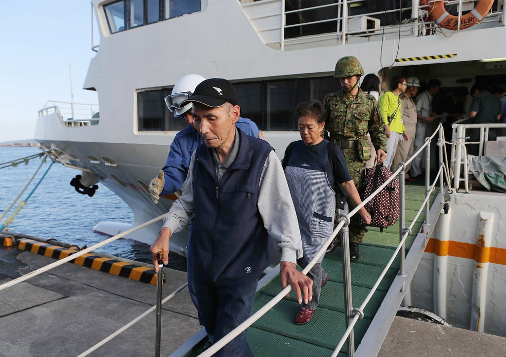. Evacuees arrive at Miyanoura Port in Yakushima Island, in the Kagoshima prefecture of Japan\'s southern island of Kyushu on May 29, 2015. Residents were evacuated to a nearby island aboard coastguard boats and a ferry, officials said. A violent volcanic eruption in southern Japan forced the evacuation of an island, as a huge column of ash was shot high into the sky.     AFP PHOTO / JIJI  PRESS/AFP/Getty Images