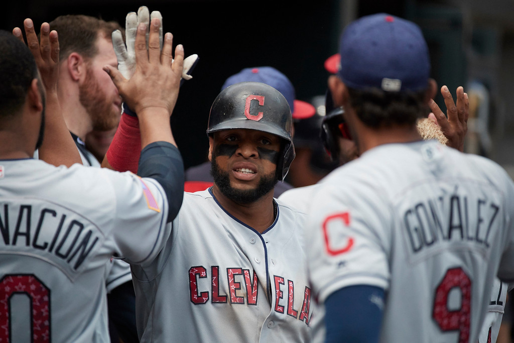 . Cleveland Indians Carlos Santana is congratulated by teammates after he hits a two run home run in the seventh inning against the Detroit Tigers in the first baseball game of a doubleheader in Detroit, Saturday, July 1, 2017. (AP Photo/Rick Osentoski)