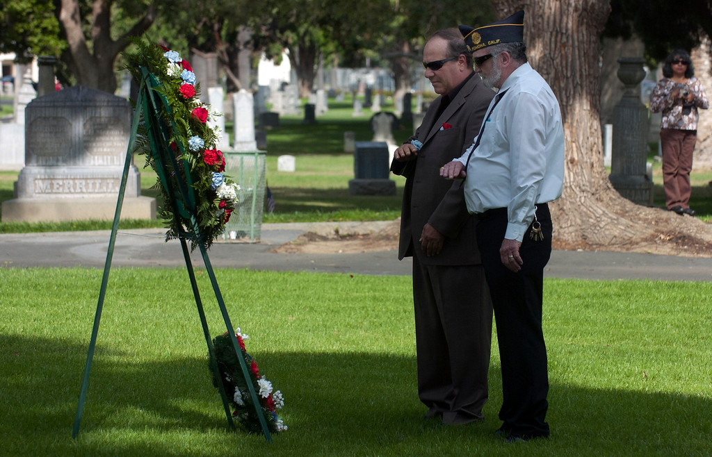 . 0528_NWS_IDB_L-POMONA-02-JCM (Jennifer Cappuccio Maher/Staff Photographer) Pomona Mayor Elliott Rothman, left, and American Legion Post 30 finance officer Thomas Carroll represent all Masons as they give a masonic presentation during Memorial Day services Monday, May 27, 2013, at Pomona Valley Memorial Park in Pomona.