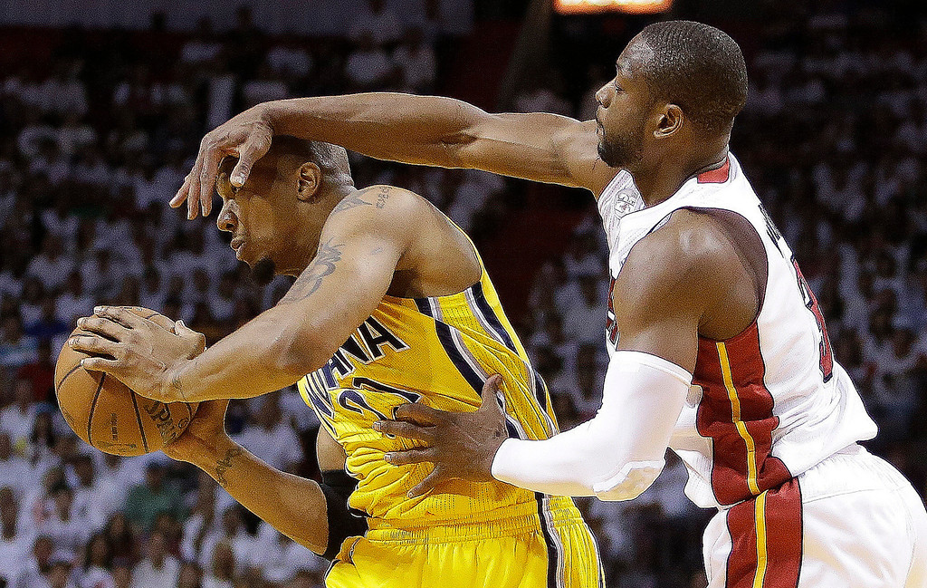 . Indiana Pacers power forward David West (21) and Miami Heat shooting guard Dwyane Wade (3) vie for the ball during the first half of Game 7 in their NBA basketball Eastern Conference finals playoff series, Monday, June 3, 2013 in Miami. (AP Photo/Lynne Sladky)