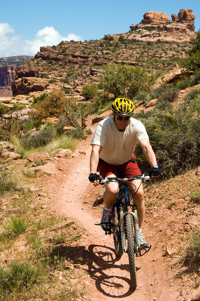 Trek Travel guest descending the Singletrack section of the Porcupine Rim trail outside of Moab, UT