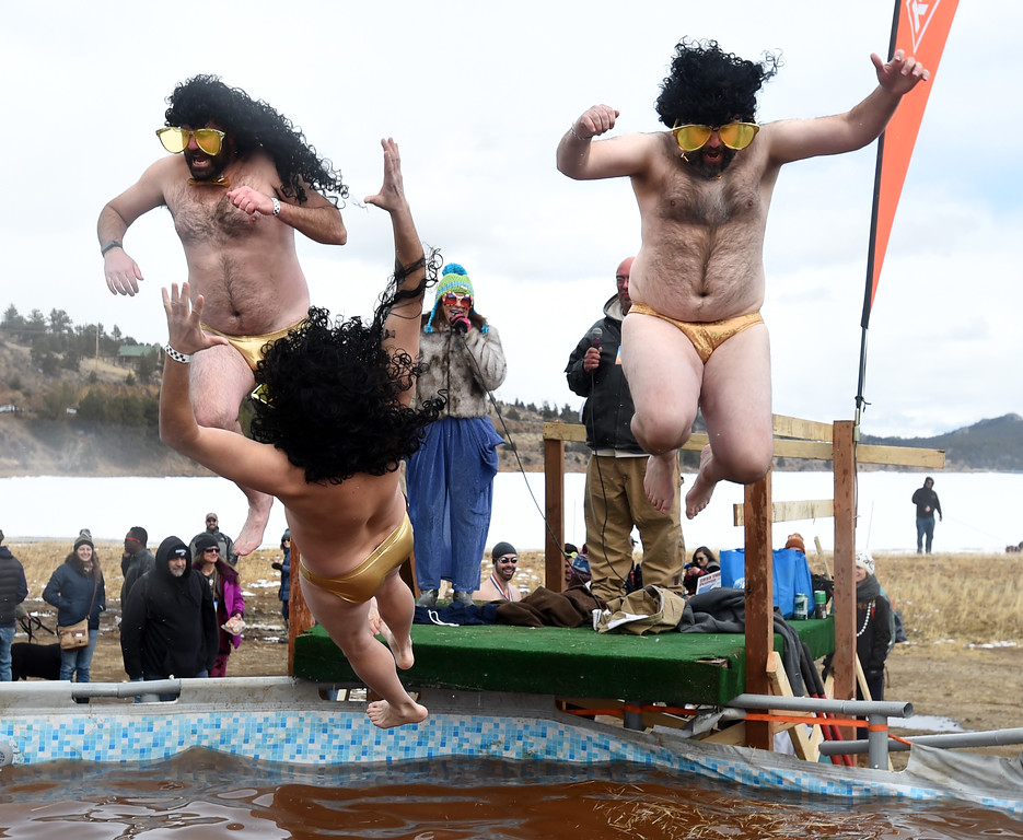. Ryan Poe, left, Danny Duke, and Bryan Kritz, relied on their Speedos to get them through the plunge  on Saturday during 2018 Frozen Dead Guy Days in Nederland. The festival continues on Sunday. For more photos, go to dailycamera.com. Cliff Grassmick  Photographer  March 10, 2018