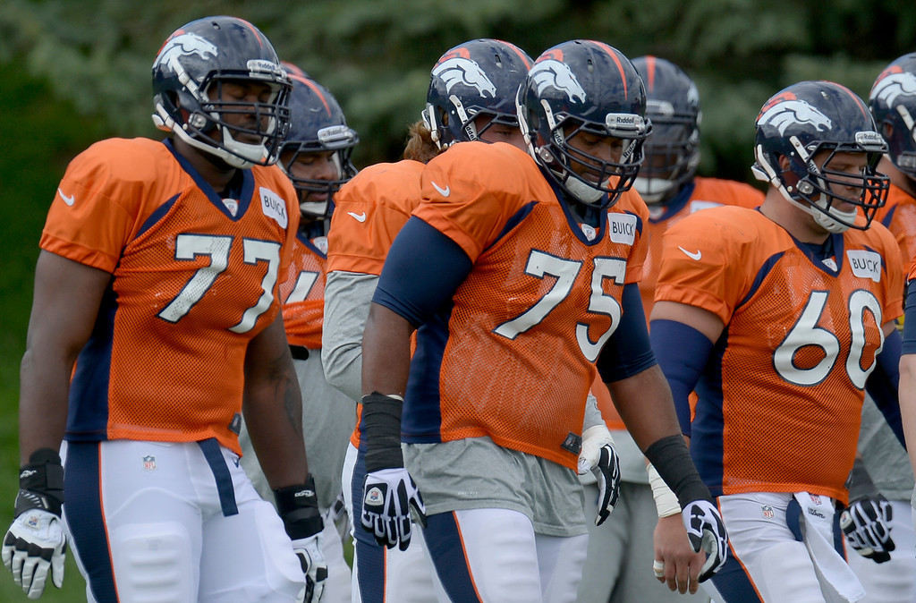 . Denver Broncos LT Chris Clark (75) works with Denver Broncos LT Winston Justice during drills at practice September 19, 2013 at Dove Valley. Clark will take the place of injured player Ryan Clady. (Photo by John Leyba/The Denver Post)