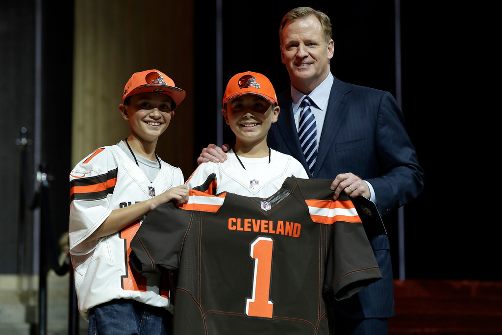. NFL commissioner Roger Goodell, right, poses with Cleveland Browns\' fans after the Browns selected Texas A&M\'s Myles Garrett with the number one overall pick by the Cleveland Browns during the first round of the 2017 NFL football draft, Thursday, April 27, 2017, in Philadelphia. (AP Photo/Matt Rourke)