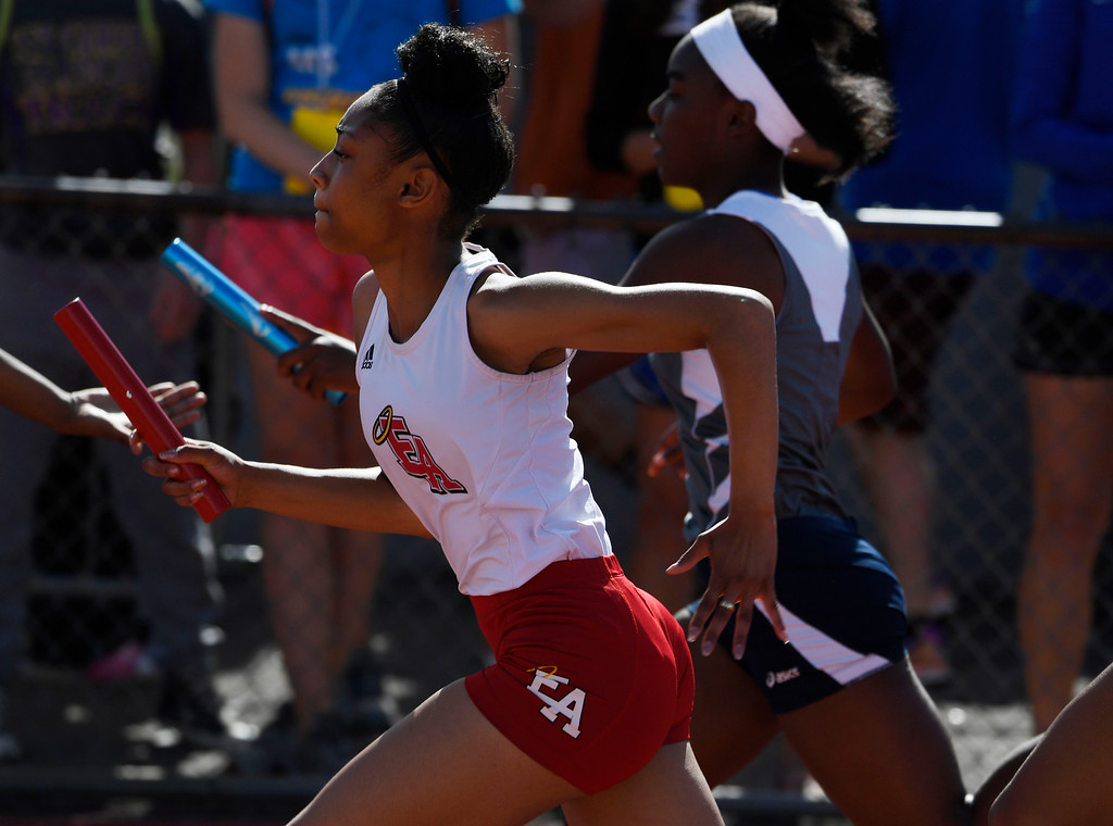 . LAKEWOOD, CO - May 20: Simone Watkins, Denver East, races down track after getting the baton from a teammate during the girls 5A 4x100 meter relay preliminary race at the Colorado State High School Track and Field Championships at Jeffco Stadium May 20, 2016. (Photo by Andy Cross/The Denver Post)