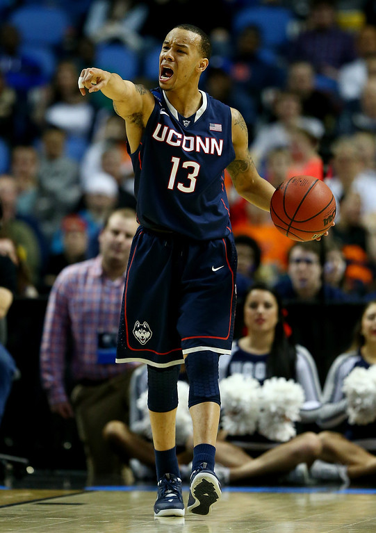 . BUFFALO, NY - MARCH 22: Shabazz Napier #13 of the Connecticut Huskies calls a play against the Villanova Wildcats during the third round of the 2014 NCAA Men\'s Basketball Tournament at the First Niagara Center on March 22, 2014 in Buffalo, New York.  (Photo by Elsa/Getty Images)