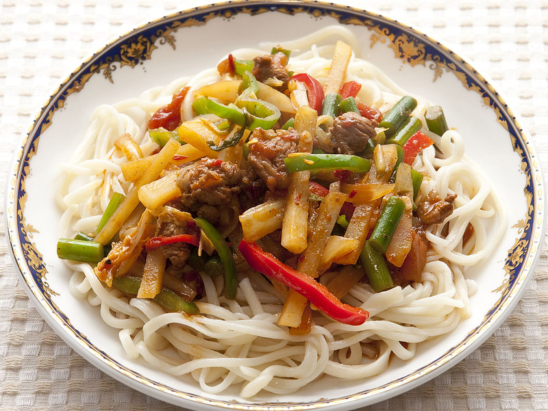 ...and tasty meals: lagman. Lagman is a very popular noodle dish.  It consists of thick stretched noodles covered in chopped peppers and other vegetables and served in a spicy vinegary sauce.  Lagman is served everywhere in Kyrgyzstan but is considered an Uyghur dish.
