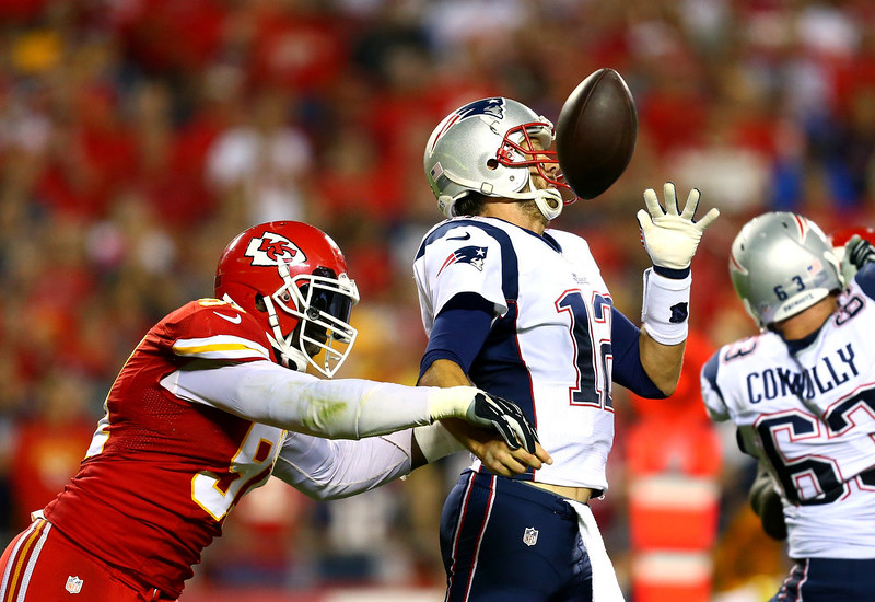 . Tamba Hali #91 of the Kansas City Chiefs knocks the ball loose from Tom Brady #12 of the New England Patriots for a fumble during the third quarter at Arrowhead Stadium on September 29, 2014 in Kansas City, Missouri.  (Photo by Dilip Vishwanat/Getty Images)