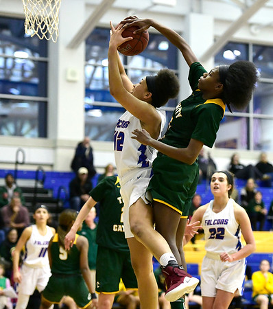 3/8/2019 Mike Orazzi | Staff St. Paul Catholic High Schools Jade Udoh (42) and Trinity Catholic's Iyanna Lops (15) during the Class S Semifinal girls basketball game at Newtown High School Friday night in Newtown.