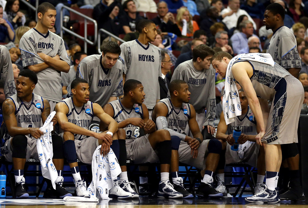. PHILADELPHIA, PA - MARCH 22:  (Seated front row L-R) D\'Vauntes Smith-Rivera #4, Otto Porter Jr. #22, Mikael Hopkins #3, Jabril Trawick #55, Markel Starks #5 and Nate Lubick #34 of the Georgetown Hoyas look on from the bench in the second half against the Florida Gulf Coast Eagles during the second round of the 2013 NCAA Men\'s Basketball Tournament at Wells Fargo Center on March 22, 2013 in Philadelphia, Pennsylvania.  (Photo by Elsa/Getty Images)