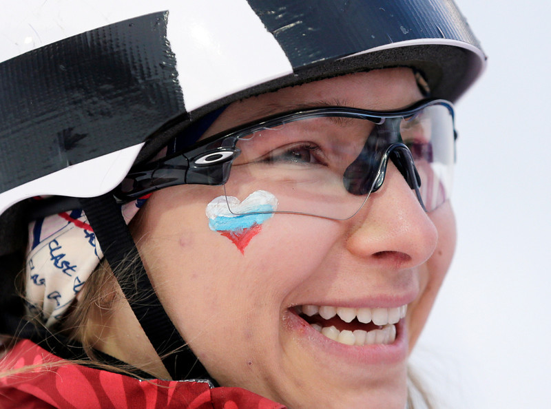 . Russia\'s Veronika Korsunova wears a heart on her cheek during the women\'s freestyle skiing aerials qualifying at the Rosa Khutor Extreme Park, at the 2014 Winter Olympics, on Valentines Day, Friday, Feb. 14, 2014, in Krasnaya Polyana, Russia. (AP Photo/Andy Wong)