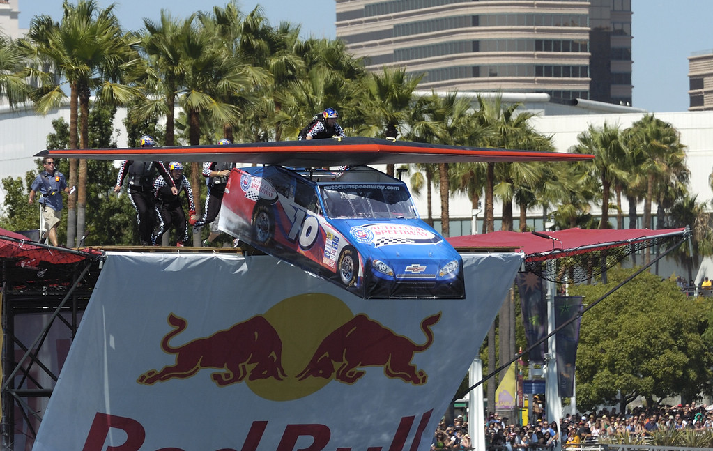 """. LONG BEACH, CALIF. USA -- Justin Bentley pilots his team\'s Flugtag entry \""""Auto Club Speedway\"""" in Rainbow Harbor in Long Beach, Calif. on August 21, 2010. Thirty five teams competed in the Red Bull event where teams build homemade, human-powered flying machines and pilot them off a 30-foot high deck in hopes of achieving flight.  Flugtag means \""""flying day\"""" in German. They are on distance, creativity and showmanship..Photo by Jeff Gritchen / Long Beach Press-Telegram.."""