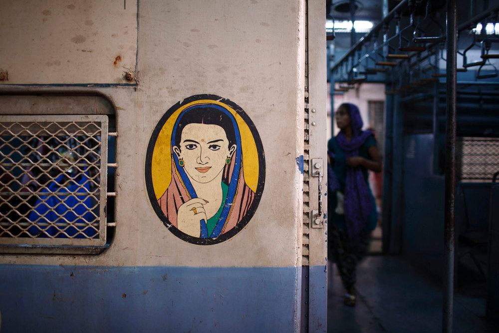 . A portrait of a woman is seen near the entrance of the female compartment of a suburban train at Chhatrapati Shivaji Terminus Railway Station in Mumbai November 2, 2012. In India some train compartments, or sometimes whole trains, are reserved specifically for female passengers in an effort to make their travel easier and more secure. The role and treatment of women in society has recently become a hot political issue in the country, since the Dec. 16 gang rape of a 23-year-old student in New Delhi, who later died of her injuries, and whose case has led to widespread protests in the region against violence against women. Picture taken November 2, 2012.          REUTERS/Navesh Chitrakar