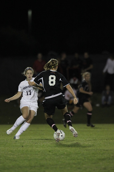 Megan Curan, 8, dribbles the ball.