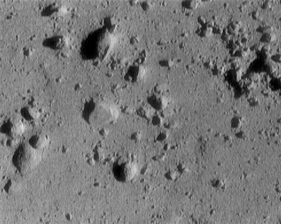 . This photo released by NASA Monday, Feb. 12, 2001, was taken by the NEAR spacecraft as it descended toward the barren, rocky, surface of the asteroid Eros. It was taken from 820 feet above the asteroid\'s surface. The image is 12 meters (39 feet) across. The cluster of rocks at the upper right measures 1.4 meters (5 feet) across. (AP Photo/HO, Johns Hopkins University Applied Physics Labratory)