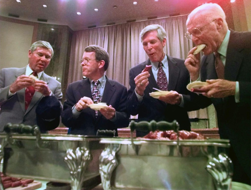 . From left, Bob Graham, D-Fla., Mike Dewine R-Ohio, Connie Mack R-Fla., and John Glenn D-Ohio, settle their World Series wager on Capitol Hill in Washington Thursday, Oct. 30, 1997. Dewine and Glenn provided the Ohio delicacies in light of the Florida Marlins winning the World Series four games to three over the Cleveland Indians. (AP Photo/Brian K. Diggs)